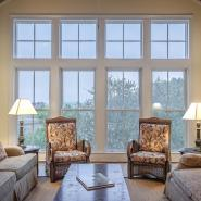 living room of a home with a window and two chairs